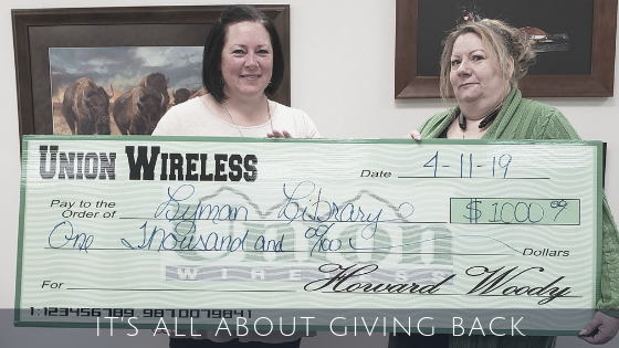Two Women Holding a Big Check